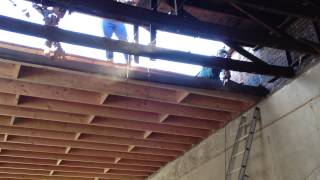 Repairing the roof on our old building in Athens, Texas.