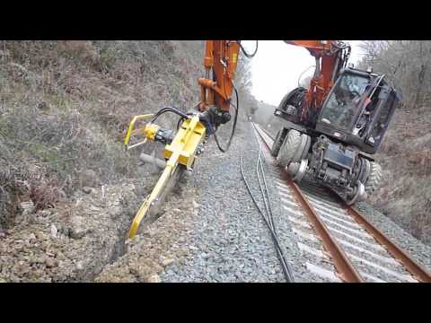 MH100 Cable laying along railway embankment