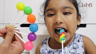 Pre school toddler Ishfi learn with colourful lollipop and finger family