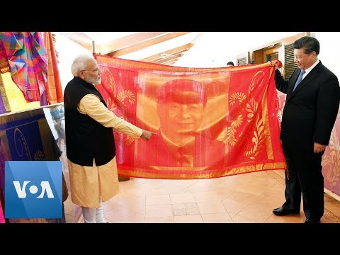 China's Xi, Indian PM Modi Give Each Other Gifts