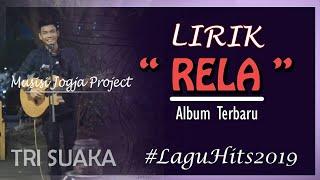 Gambar cover Tri Suaka - Aku Rela ( Official Lyric) Terbaru