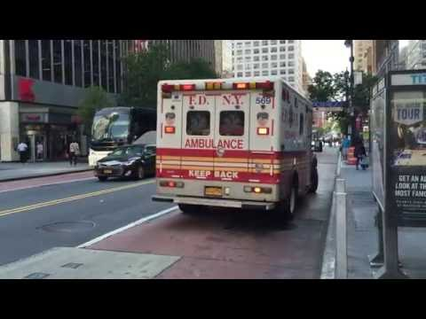 FDNY RESCUE MEDICS AMBULANCE RESPONDING ON WEST 34TH STREET IN MIDTOWN, MANHATTAN IN NEW YORK CITY.