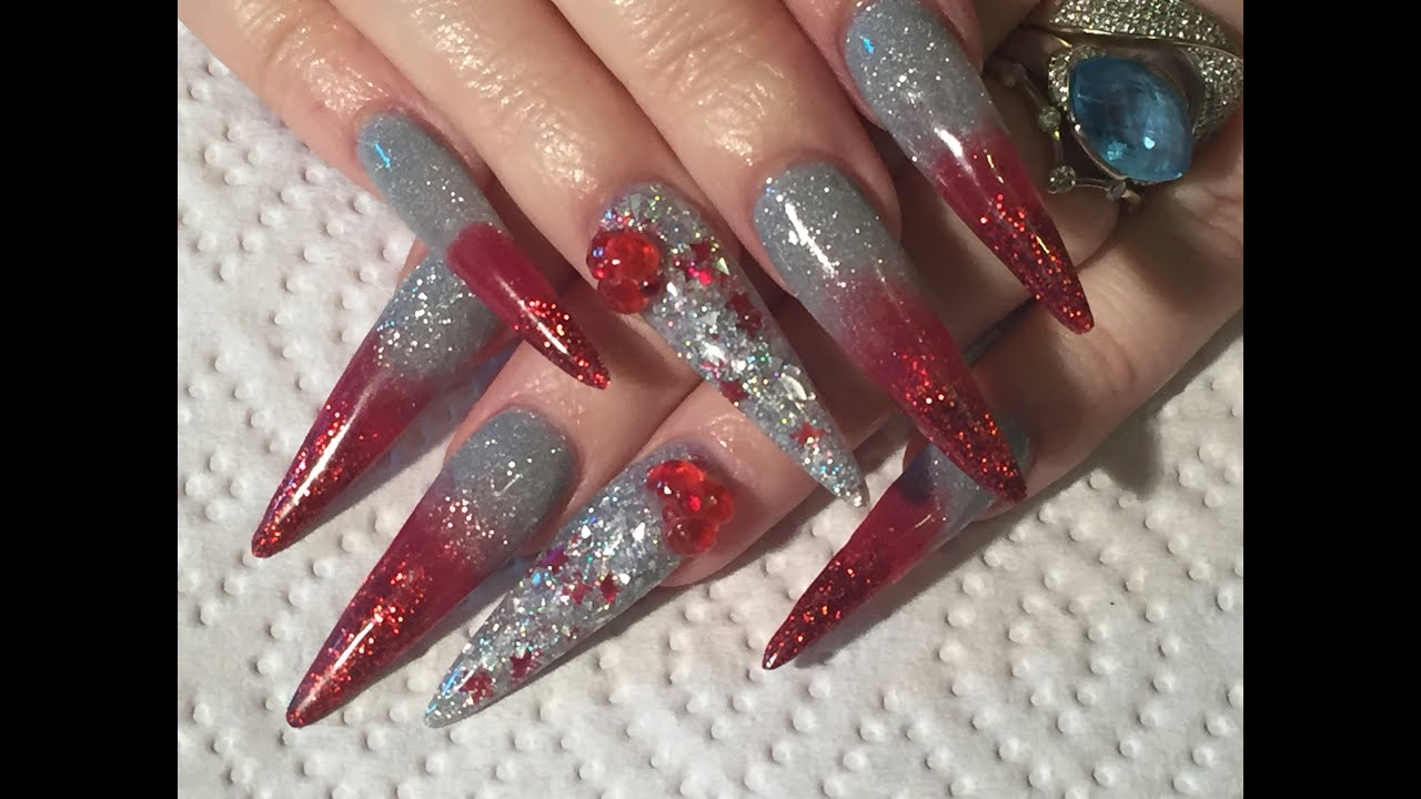acrylic nails - sculpted red and silver sparkly stilleto nails
