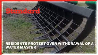 Residents protest over plans of withdrawal of a water master used to desilt streams in the area