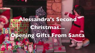 Baby Opens Christmas Gifts From Santa
