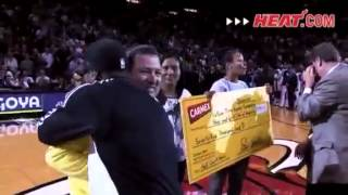 Repeat youtube video LeBron James hugs Miami Heat fan that hits $75k half-court shot