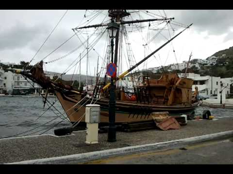 Pirate ship in Ios harbor, Greece. Force 9 storm at sea. Yachts in danger.