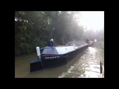 Working Barges on misty Oxford canal