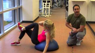100 best ab exercises   bosu crunch with twist and leg extension