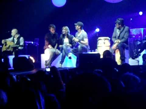 Brother and sister on stage with Enrique Iglesias