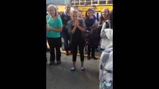 Navy sailor surprising sister at school