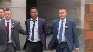 Actor Cuba Gooding Jr. led by police in handcuffs
