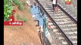 Car falls from the over bridge to the railway line at Kharagpur