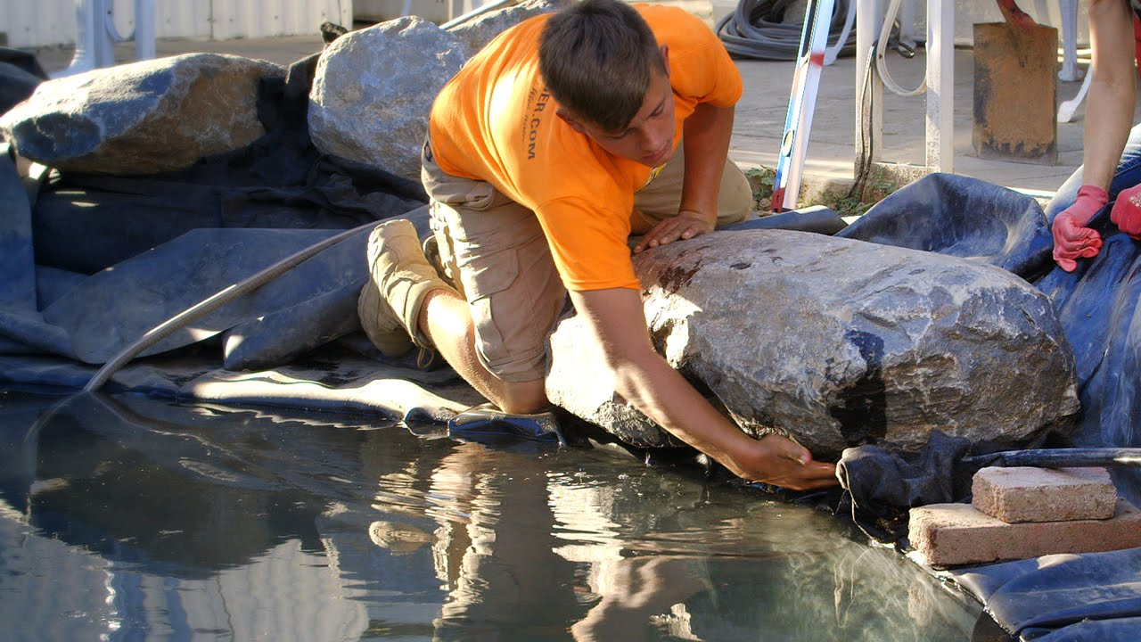 Edging stones around ponds edge 1 kp 31 youtube for Decorative fish pond covers