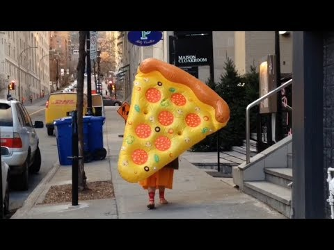 Going to the mall with a giant inflatable slice of pizza