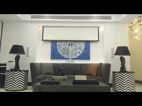 Modern Marine Drive Apartment Adds Surround Sound And A Screen Entertainment System