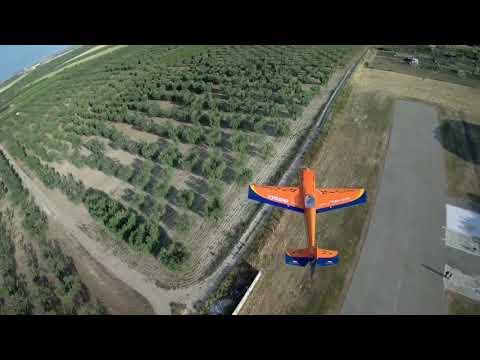 Фото CINEMATIC - FPV DRONE TRACKS ACROBATIC RC PLANE