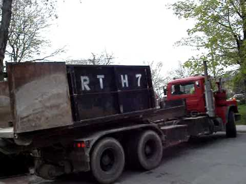 Delivery of screening and waste disposal bin