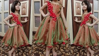 Beautiful kids frock with fabric flowers cutting and stitching
