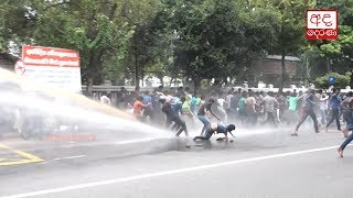 Police use water cannons on protesting SE university students