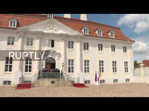 Germany: Merkel Greets Macron At Bilateral Meeting In Meseburg