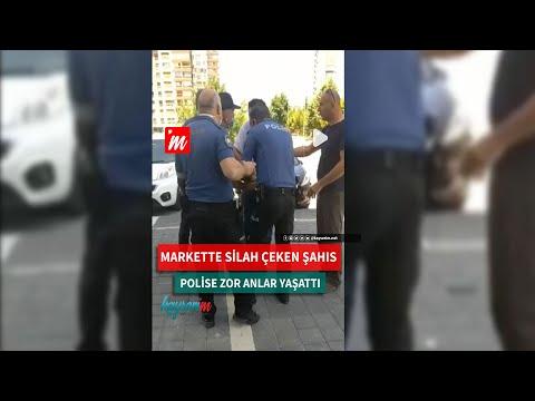 Markette silah çeken şahıs, polise zor anlar yaşattı