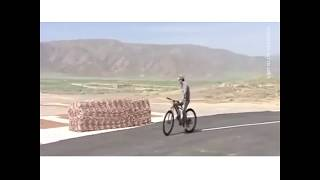 President of Turkmenistan practices drive-by shooting tactics on a bike because.. why not?