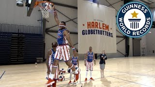 Most blindfolded basketball slam dunks in one minute - Guinness World Records
