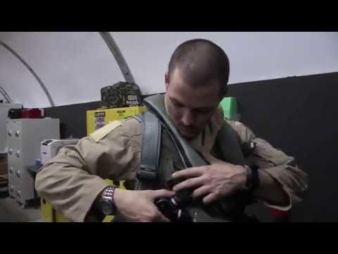 Join F-22 pilots preparing for a night air strike mission in the Raptor