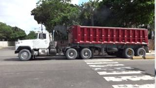2 Mack RD trucks with a dump trailer