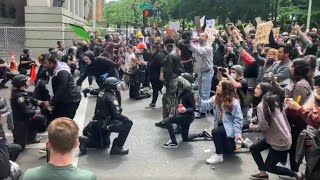 Raw video: Portland police officers kneel with protesters