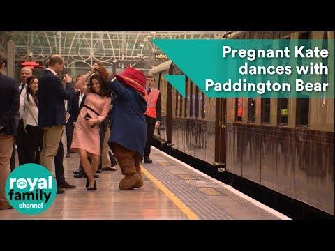Pregnant Kate dances with Paddington Bear at Paddington Station