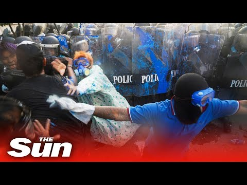 Live: Thai police fire water cannon at parliament protesters