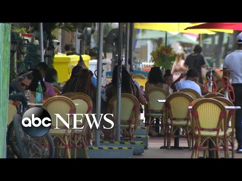 Florida lifts restrictions on restaurants, suspends fines for not wearing masks