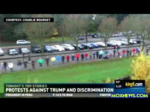 [News Today] - Anti Trump Protesters Holds Hands Around Green Lake In Seattle