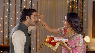Beautiful Indian wife putting tikka on her husband's forehead on the occasion of Karwa Chauth