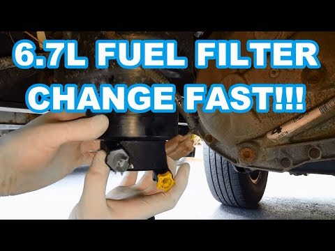 FORD 6.7L FUEL FILTER CHANGE FAST!!! 2011-2016 F350 Powerstroke how to change fuel filters reset