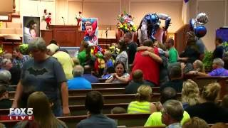 Young boy gets superhero funeral