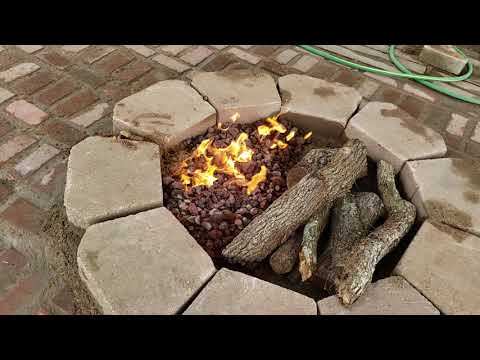 DIY Dual Half propane gas fire pit and half wood burning campfire.