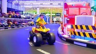 Artem plays in the park and ride on cars with power wheels