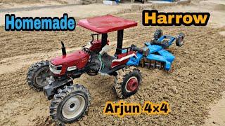 Arjun 4by4 Tractor with Harrow video in YouTube by Mr.Pendu jatt