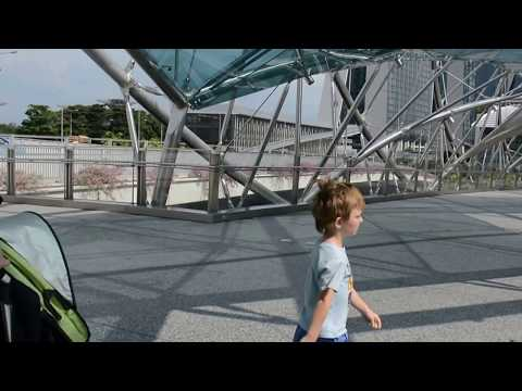 Crossing the Helix Bridge in Singapore with our son on the autism spectrum