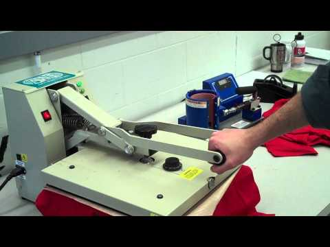 Using the heat press for thermal transfer on to a shirt
