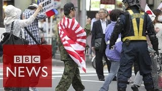 Social media tackles racism in Japan #BBCtrending - BBC News