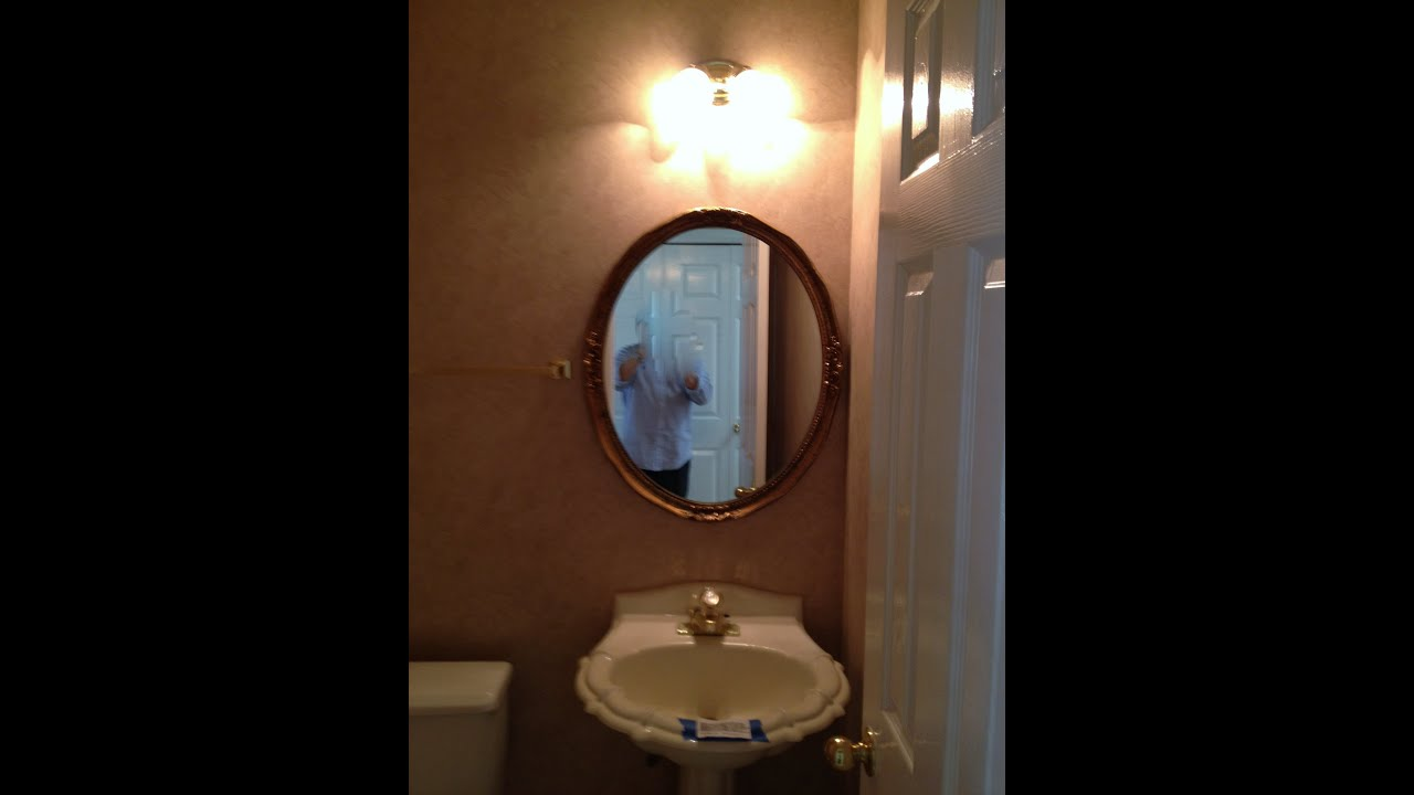 spray painted mirror with rustoleum oil bronze spray paint before and after