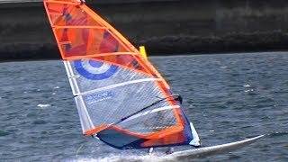 Windsurfers having a