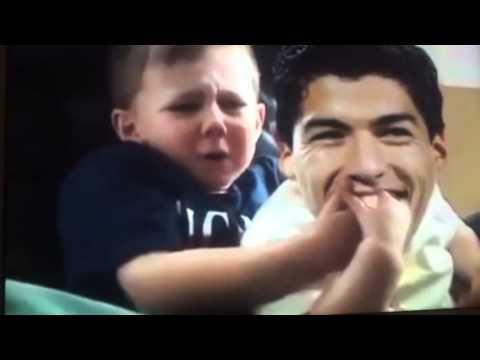 Luis Suarez bites child