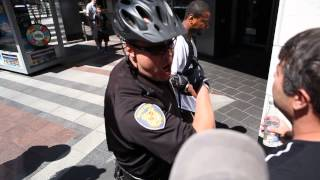 Innocent bystander pepper sprayed and arrested by Westlake security during protest in Seattle