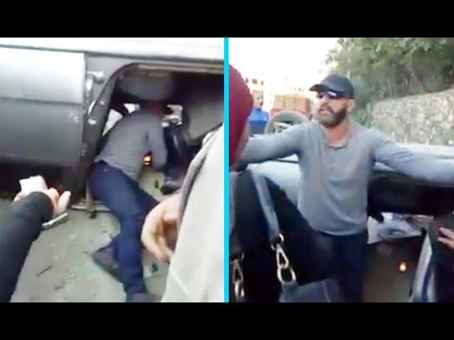 شاهد بالفيديو الموقف البطولي الخطير لاحمد السقا بمساعده امراه انقلبت سيارتها في الشارع