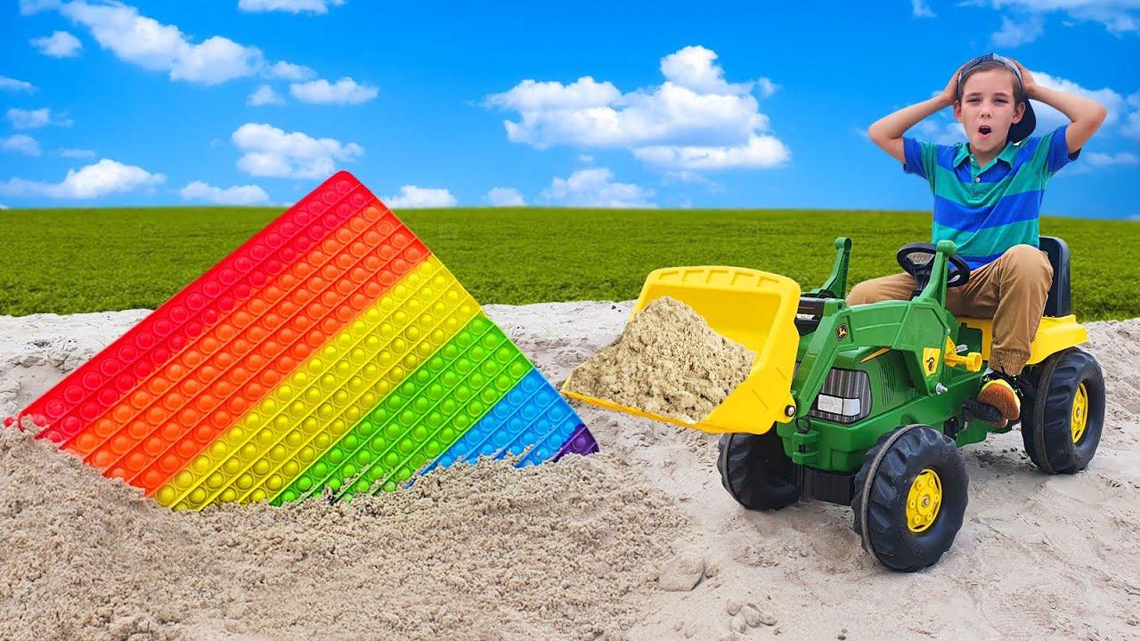 Tractor John Deere finds a Huge Pop it in the Sand